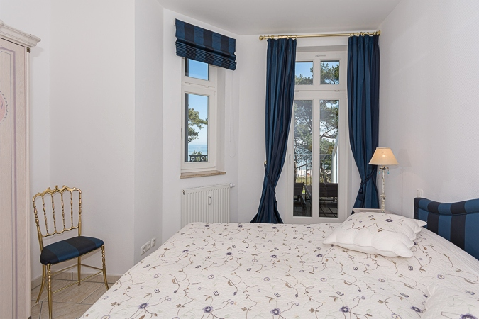 Villa Atlantic - Appartement Baltic Melody - Schlafzimmer mit Doppelbett